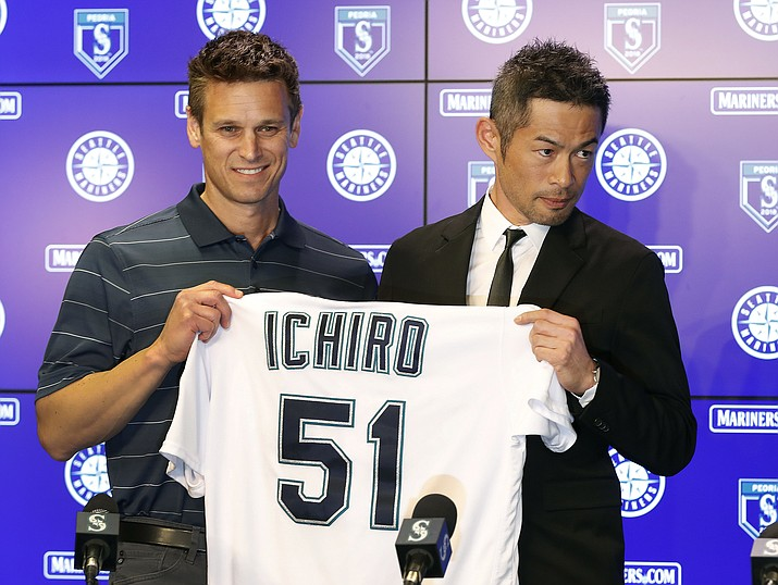 Seattle Mariners' Ichiro Suzuki, right, holds up his jersey with Mariners' G.M. Jerry Dipoto during a news conference at the teams' spring training baseball complex Wednesday, March 7, 2018, in Peoria, Ariz. Suzuki signed a one year deal in his return to the Mariners. (Matt York/AP)