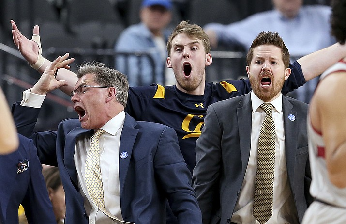 California's bench reacts to a call during the first half of an NCAA college basketball game against Stanford in the first round of the Pac-12 men's tournament Wednesday, March 7, 2018, in Las Vegas.