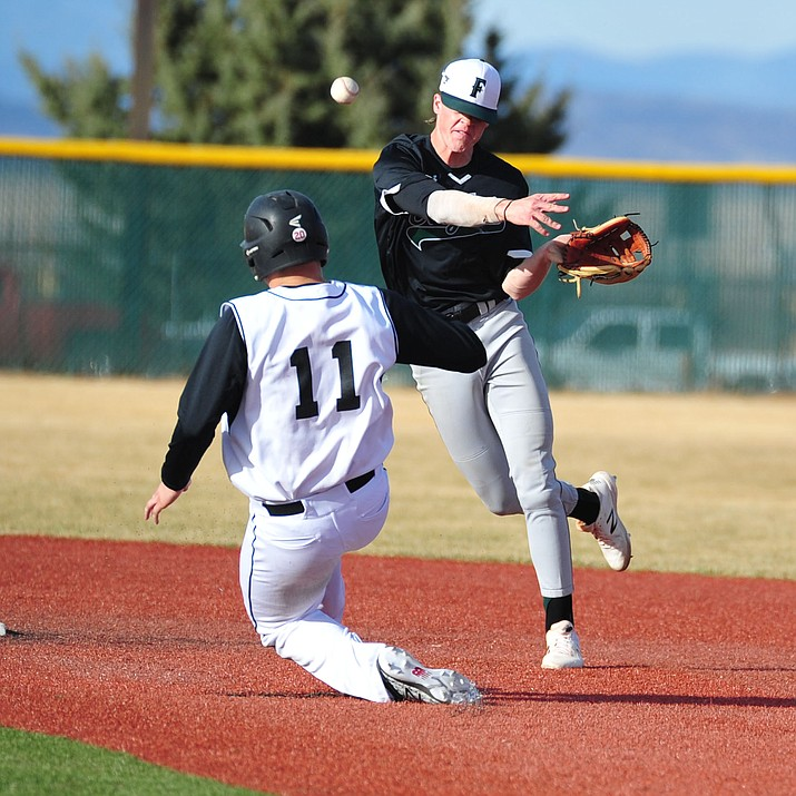 Bradshaw Mountain's Tim Young tries to break up the double play as the Bears take on the Flagstaff Eagles Thursday afternoon in Prescott Valley. (Les Stukenberg/Courier)