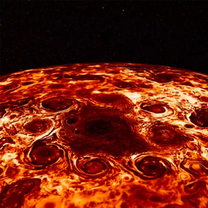 This composite image provided by NASA, derived from data collected by the Jupiter-orbiting Juno spacecraft, shows the central cyclone at the planet's north pole and the eight cyclones that encircle it. Jupiter's poles are blanketed by geometric clusters of cyclones and its atmosphere is deeper than suspected, scientists reported Wednesday, March 7, 2018. (NASA/JPL-Caltech/SwRI/ASI/INAF/JIRAM)
