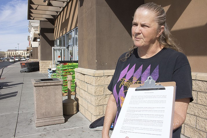 Penny Gabriel stands outside Big Lots Thursday trying to get people to sign her petition to increase school safety.