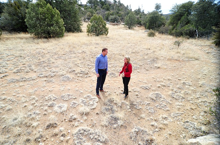 Granite Mountain School Principal Teresa Bruso and Yavapai County Schools Administrator Stan Goligoski walk a piece of land that could possibly be used for new teacher housing next to the school in Prescott. (Les Stukenberg/Courier)
