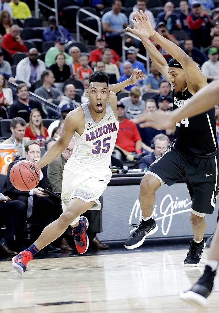 Arizona's Allonzo Trier (35) drives past Colorado's George King (24) during the first half of an NCAA college basketball game in the quarterfinals of the Pac-12 men's tournament Thursday, March 8, 2018, in Las Vegas.