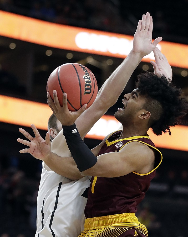 Arizona State's Remy Martin, right, shoots while defended by Colorado's Lucas Siewert, left, during the first half of an NCAA college basketball game in the first round of the Pac-12 men's tournament Wednesday, March 7, 2018, in Las Vegas.