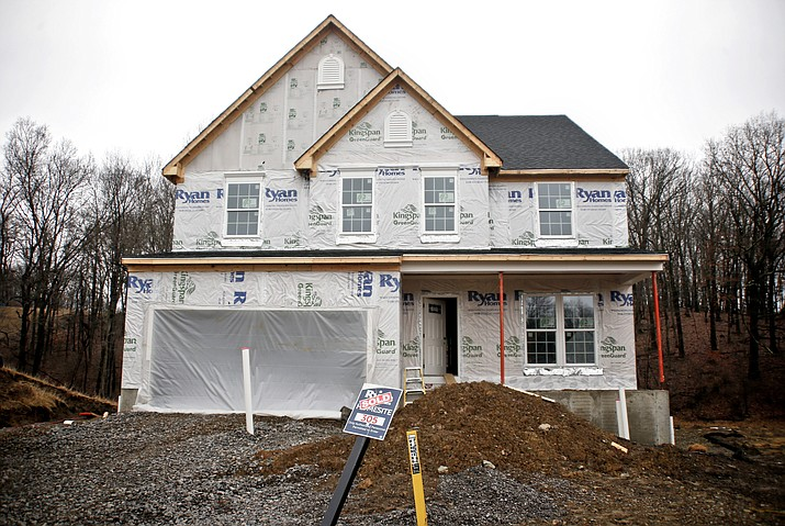 """In this Friday, Feb. 16, 2018, photo, construction is under way at a new housing plan in Zelienople, Pa. With the supply of existing homes available to buy at """"an all-time low"""" nationwide, according to the National Association of Realtors, homebuyers are looking at other options that include building a house.  (Keith Srakocic/AP)"""