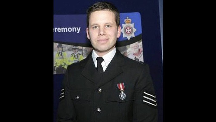"This undated handout photo provided by Wiltshire Police on Thursday, March 8, 2018 shows Detective Sergeant Nick Bailey. Whoever attacked Sergei Skripal, a former Russian spy, with a rare nerve agent is guilty of a ""brazen and reckless act,"" and Britain will respond without hesitation when it becomes clear who is responsible, the country's security minister said Thursday. Skripal and his daughter are in critical but stable condition at a hospital in Salisbury. A police officer who came to their aid is in a serious condition, though he is conscious and talking, Rudd said. He was identified Thursday as Sgt. Nick Bailey. (Wiltshire Police)"