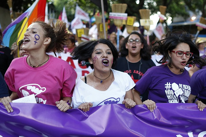 Women shout slogans during an International Women's Day march in Asuncion, Paraguay, Thursday, March 8, 2018. Women marched to protest violence against women. (AP Photo/Jorge Saenz)