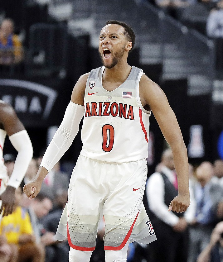 Arizona's Parker Jackson-Cartwright celebrates during overtime in an NCAA college basketball game against UCLA in the semifinals of the Pac-12 men's tournament Friday, March 9, 2018, in Las Vegas. Arizona won 78-67.