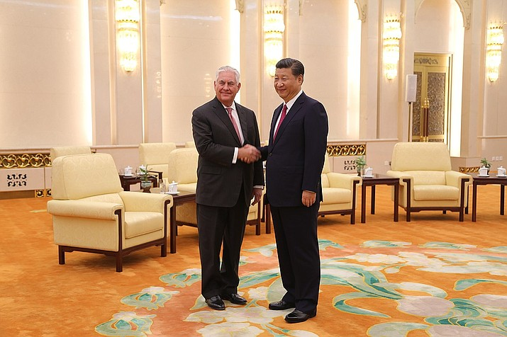 In this Sept. 30, 2017 photo, U.S. Secretary Tillerson meets with Chinese President Xi Jinping at the Great Hall of the People in Beijing, China. As China prepares to approve constitutional changes Sunday, March 11, 2018, to allow Xi to rule indefinitely, signs of dissent and satire have been all but snuffed out. (U.S. State Department photo)