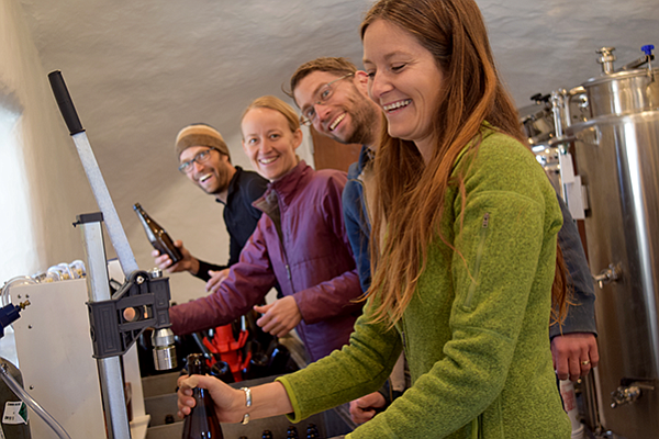 Enjoying the process of bottling a batch of 2017 Stoic Cider are, from right, Clare Stielstra, Cody Routson, Tierney Schipper, and Kanin Routson.