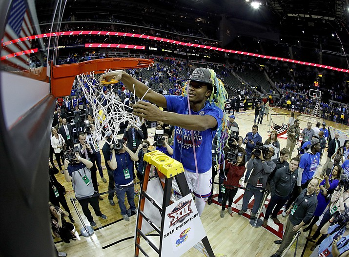 kansas devonte graham cuts the net after winning the ncaa college basketball championship game