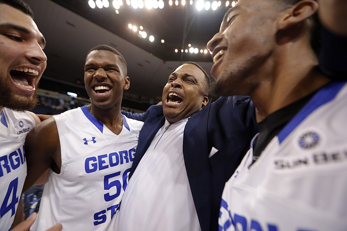 Georgia State head coach Ron Hunter celebrates with his team after their victory over Texas-Arlington in the Sun Belt Conference championship game Sunday, March 11, 2018, in New Orleans. Georgia State won 74-61. (Gerald Herbert/AP)