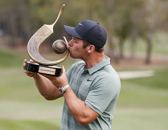 Paul Casey kisses the champion's trophy after winning the Valspar Championship golf tournament Sunday, March 11, 2018, in Palm Harbor, Fla. (Mike Carlson/AP)