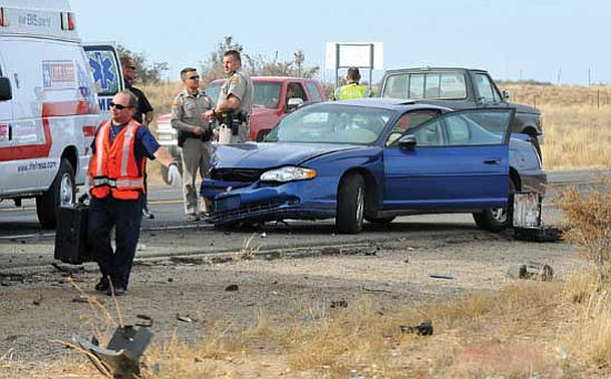 Emergency workers examine the scene of a two-vehicle accident on Highway 89 north of the Prescott airport Nov. 11, 2009. (Courier, File)
