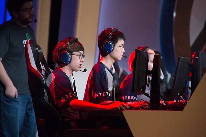 Benjy Duggan, left, and Cory Shen of the University of Arizona team, play an exhibition match of Overwatch against Arizona State University at the 2018 Fiesta Bowl Overwatch Collegiate National Championship.