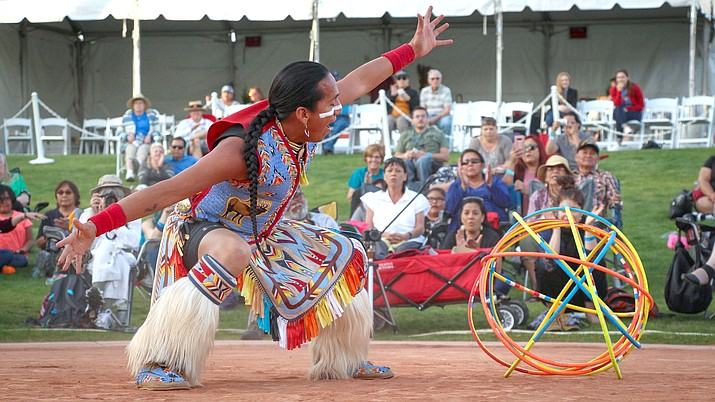 Tony Duncan strikes a final pose in the World Championships of Hoop Dancing in Phoenix. He can aslo play the traditional flute.