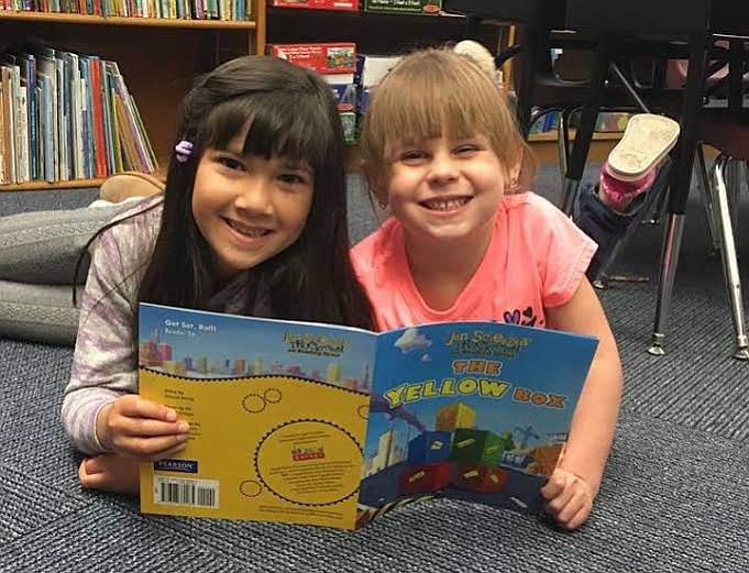 Samantha Sar, at left, is 6 years old, and Madison Sturdevant is 5 years old. They are students in Melanie Goldsmith's kindergarten class at Taylor Hicks Elementary School. (Denise Murphy/Courtesy)