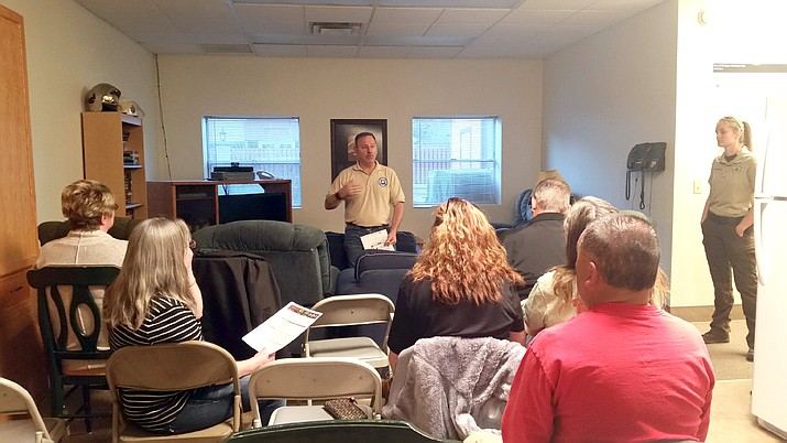 Jon Paxton, community programs planner for the Coconino County Sheriff's Office, leads Tusayan residents through the Ready, Set, Go! program. (Erin Ford/WGCN)
