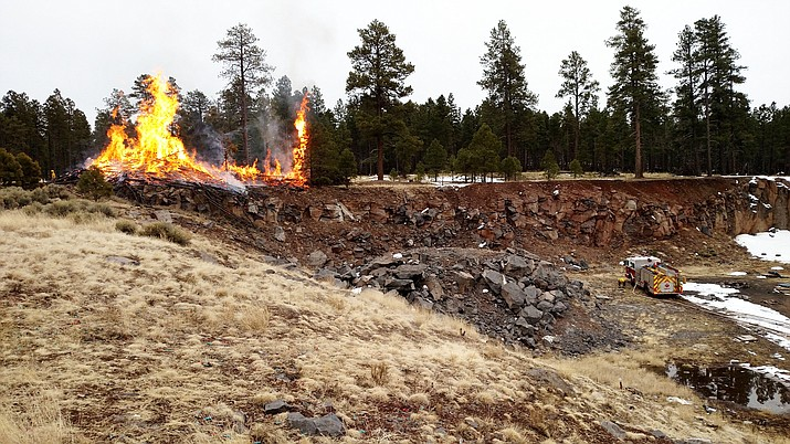On March 7, Ponderosa Fire District, Camp Navajo, Coconino County Sheriff's Office, Coconino National Forest and Arizona Department of Forestry and Fire Management responded to a 50 foot slash pile on fire near Bellemont. (Photos/Ponderosa Fire)