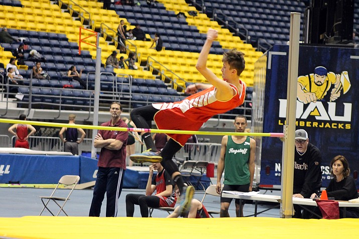 Sophomore Nolan Lyle clears 5 feet in the high jump. (Erin Ford/WGCN)