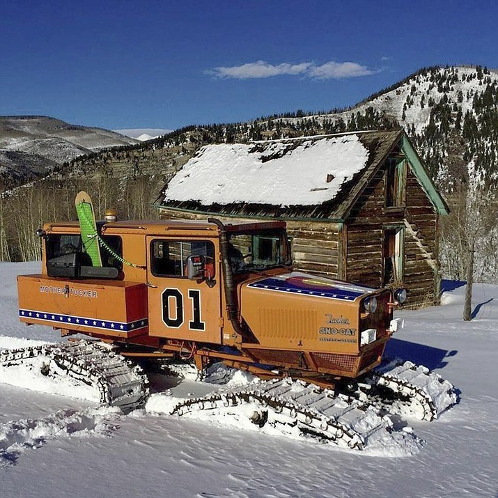 "This undated photo provided by John Brandenburg shows a Sno-Cat co-owned by Brandenburg. Authorities in Colorado are looking for a man suspected of stealing the Sno-Cat fitted out to look like the ""General Lee,"" the famous car featured in the classic television series ""The Dukes of Hazzard."" (John Brandenburg via AP)"