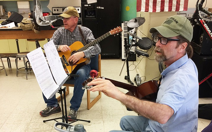 U.S. Army veteran Dave Mundee, at right, and volunteer instructor Steve Osborn, a U.S. Marine veteran, are pictured Wednesday, March 7, in the recreation room of the domiciliary at the Veterans Affairs campus Wednesday, March 7, in Prescott. (Nanci Hutson/Courier)