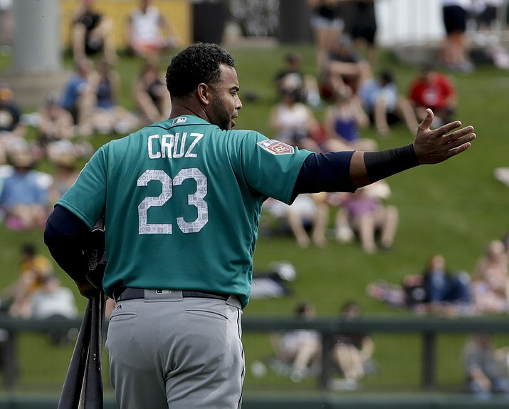 Seattle Mariners' designated hitter Nelson Cruz gestures as he leaves during the first inning against the Colorado Rockies in Scottsdale, Tuesday, March 13, 2018. (Chris Carlson/AP)