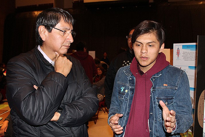 Vice President Jonathan Nez, left, listens as 18-year-old Corwin Bahe, a senior at Holbrook Seventh-Day Adventist Indian School, explains his science fair project. (Submitted photo)