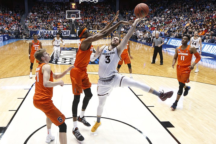 Syracuse's Paschal Chukwu, center left, blocks a shot by Arizona State's Mickey Mitchell (3) during the first half of a First Four game of the NCAA men's college basketball tournament Wednesday, March 14, 2018, in Dayton, Ohio.
