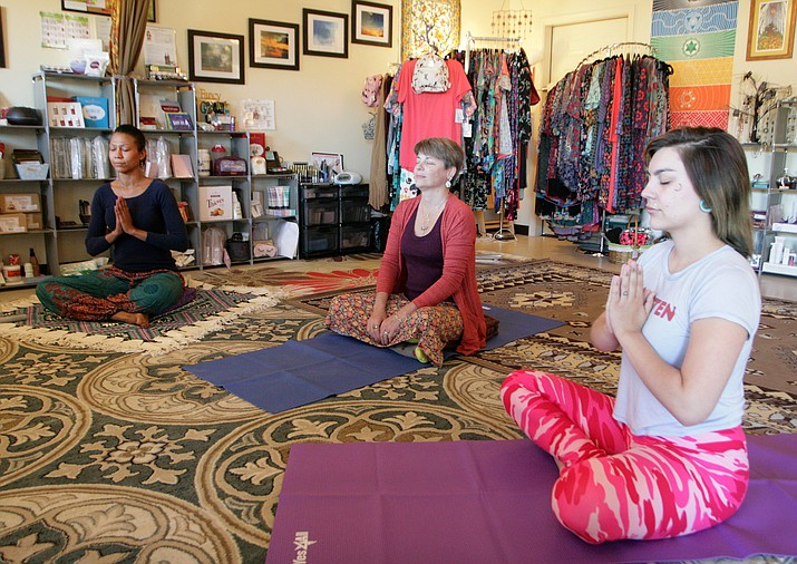 Amethyst Sattva, Christine Dargon and Quiera Clawson, from left, work on their yoga at Dargon's new Rimrock business, Emerald Waves Healing. Located at 3470 E. Beaver Creek Road, Suite A, Emerald Waves Healing is open by appointment. (VVN/Bill Helm)