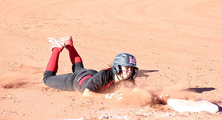 Mingus junior Lacey Saravo slides into third base after surviving a rundown during the Marauders' 9-1 win over Scottsdale Saguaro on Monday at home.  (VVN/James Kelley)