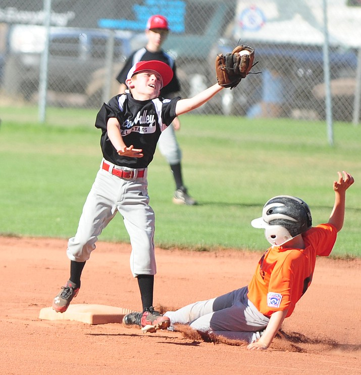 Prescott Valley's Dylan Turk tries to tag out Williams' Cody Jensen as the Prescott Valley All Stars play the Williams All Stars in the first round of the Little League District 10 Tournament in 2014. (Les Stukenberg/Courier, file)