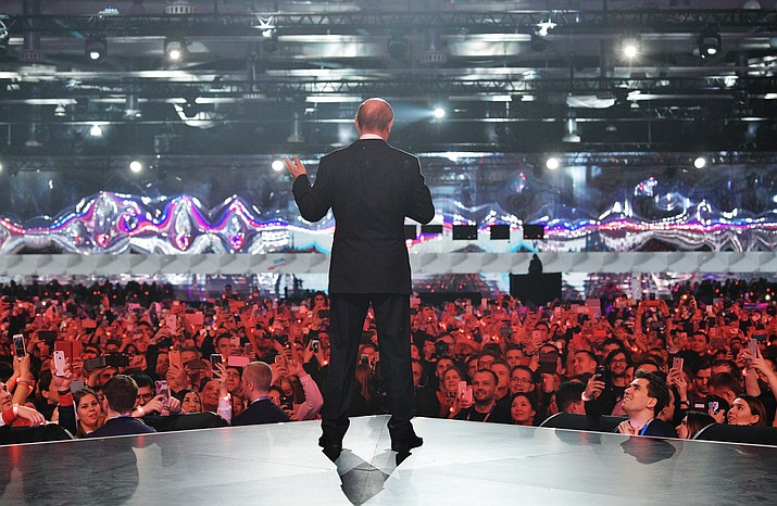 """Russian President Vladimir Putin gestures while speaking at a youth forum """"Russia, Land of Opportunity"""" in Moscow, Russia, Thursday, March 15, 2018. (Alexei Druzhinin, Sputnik, Kremlin Pool Photo)"""