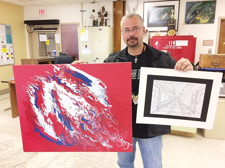 """VA domiciliary client Roy Taliaferro, a U.S. Army veteran, with one of his """"dirty pour"""" paintings and one of his three-dimensional pencil sketches. (Nanci Hutson/Courier)"""