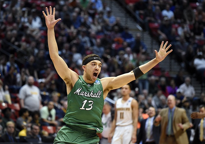 Marshall guard Jarrod West (13) reacts as time runs out in their first-round NCAA college basketball tournament game against Wichita State Friday, March 16, 2018, in San Diego. Marshall won 81-75.