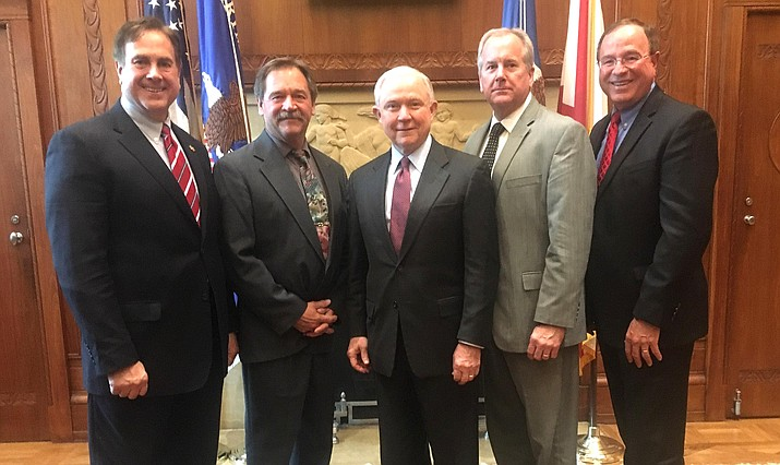 From left, Sheriff Mike Bourchard of the Oakland County Sheriff's Office in Michigan, Yavapai County Sheriff Scott Mascher, Attorney General  Jeff Sessions, Sheriff David Walcher of the Arapahoe County Sheriff's Office in Colorado, and Sheriff Grady Judd of the Polk County Sheriff's Office in Florida.