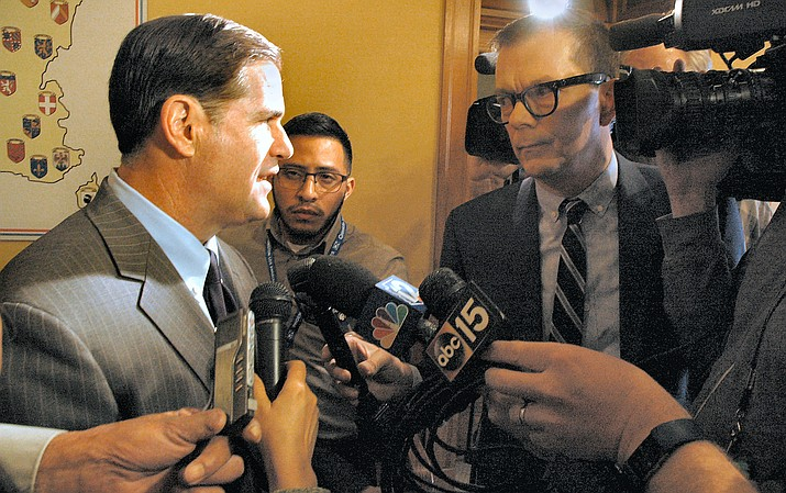 Gov. Doug Ducey with reporters (Capitol Media Services 2018 file photo by Howard Fischer)