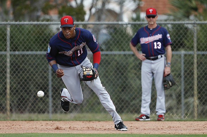 In this Feb. 21, 2018, file photo, Minnesota Twins shortstop Jorge Polanco (11) practices a drill during baseball spring training in Fort Myers, Fla. Polanco has been suspended 80 games after testing positive for a performance-enhancing substance. The commissioner's office announced the penalty Sunday, March 18. Polanco tested positive for Stanozolol. (John Minchillo/AP, File)