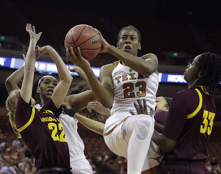 Texas guard Ariel Atkins (23) drives to the basket between Arizona State guard Courtney Ekmark (22) and center Charnea Johnson-Chapman (33) during a second-round game in the NCAA women's college basketball tournament Monday, March 19, 2018, in Austin, Texas. (Eric Gay/AP)