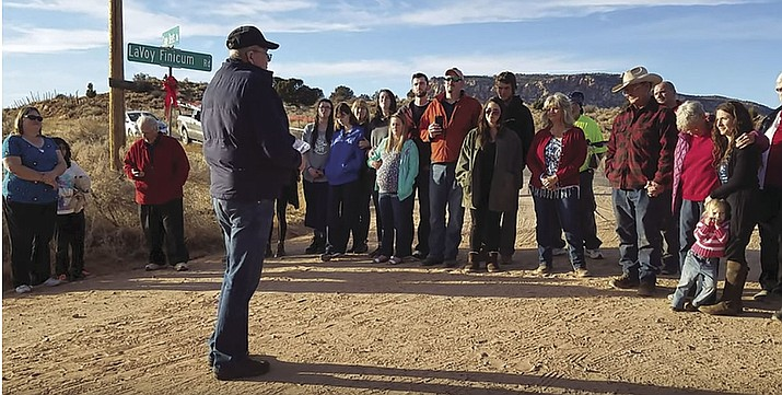 Family and friends of LaVoy Finicum participate in a January ribbon cutting after Mohave County Supervisors agreed to name the road after the slain militia leader who participated in 2016's takeover of a national wildlife refuge in Oregon.