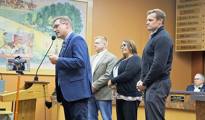 Prescott Mayor Greg Mengarelli, left, introduces members of the new Mayor's Commission on Veterans Initiatives. Members are: John Markham, second from left, Michelle Stacy-Schroeder, center, Stan Goligoski, and, not pictured, Pat Kuykendall. (Cindy Barks/Courier)