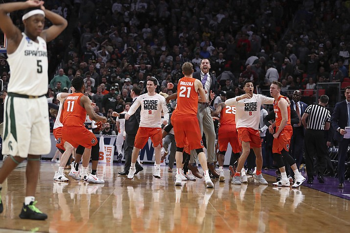 Michigan State guard Cassius Winston (5) walks off the court as Syracuse celebrates a 55-53 win in a second-round game in the NCAA men's college basketball tournament Sunday, March 18, 2018, in Detroit. (Carlos Osorio/AP, File)