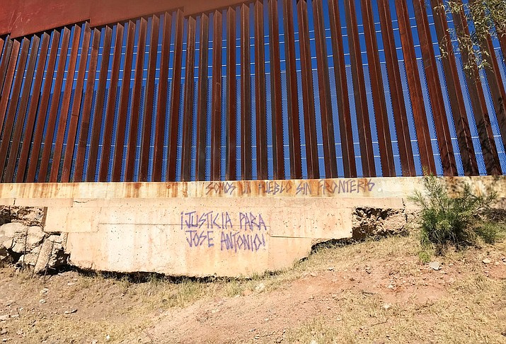A slogan asking for justice for 16-year-old Mexican youth Jose Antonio Elena Rodriguez, who was shot and killed on a street in Nogales, Sonora, Mexico, is displayed on the streets' border wall where he was killed. A U.S. border patrol agent is going on trial for second-degree murder in U.S. District Court in Tucson on Tuesday, March 20, 2018. (AP file photo/Anita Snow)