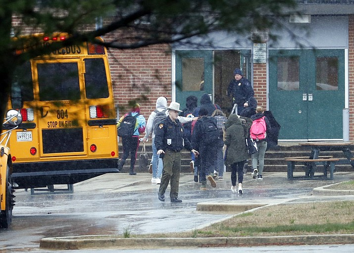 Police move students into a different area of Great Mills High School, the scene of a shooting, Tuesday morning, March 20, 2018 in Great Mills, Md. (AP Photo/Alex Brandon )