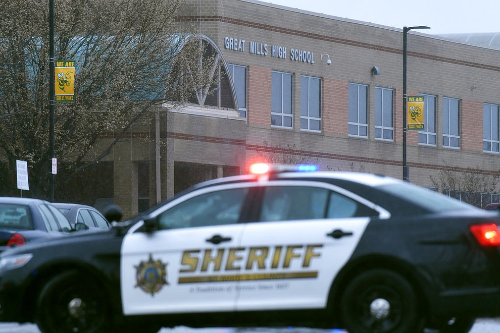 Deputies, federal agents and rescue personnel, converge on Great Mills High School, the scene of a shooting, Tuesday morning, March 20, 2018 in Great Mills, Md.  (AP Photo/Susan Walsh)