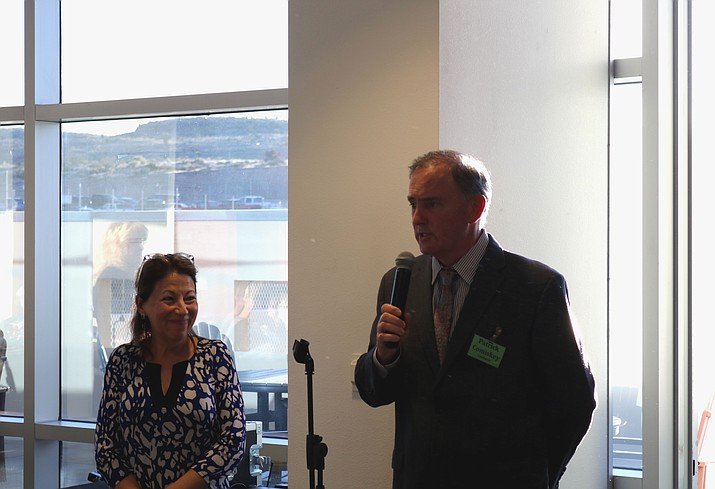 City manager finalist Patrick Comiskey addresses meet and greet attendees as Mayor Monica Gates listens Monday night.