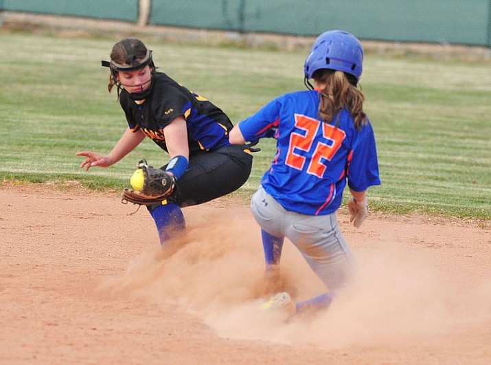 Kingman's Emily Harms tries to tag out Chino Valley's Jacey Buchanan in a region game Tuesday. The Lady Bulldogs lost 11-1.