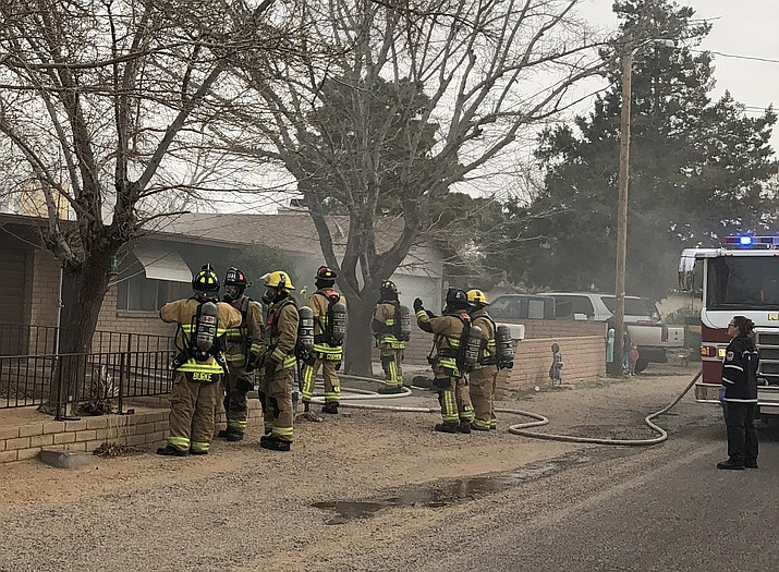 Kingman firefighters at the fire in the 2200 block of Lucille Avenue Tuesday morning.