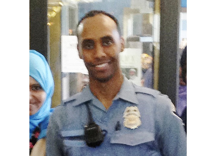 In this May 2016 file photo provided by the City of Minneapolis, police Officer Mohamed Noor poses for a photo at a community event welcoming him to the Minneapolis police force. Noor, a Minneapolis police officer who shot and killed an Australian woman in July 2017, turned himself in Tuesday, March 20, 2018, after a warrant was issued for his arrest, but the nature of the charges against him were not immediately known. (City of Minneapolis)