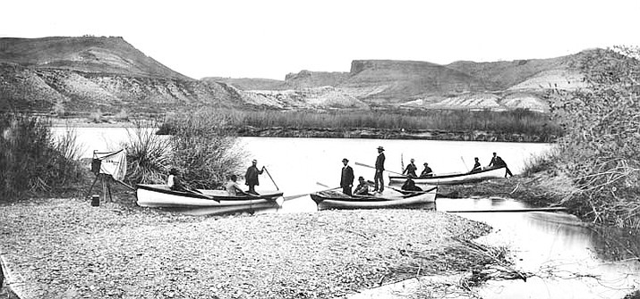 Members of the second Powell Expedition preparing to depart from Green River, Wyoming May 22, 1871. Jones is seated to the left of John Wesley Powell in the Emma Dean (center). (Photo courtesy of Grand Canyon National Park Museum Collection)